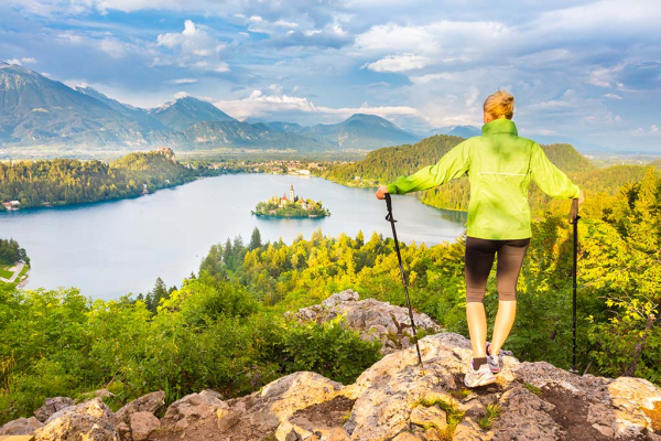Woman hiker watches Lake Bled
