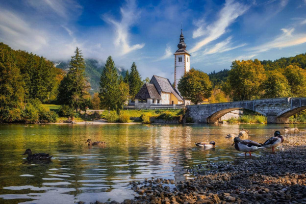 Church and the lake in Bohinj
