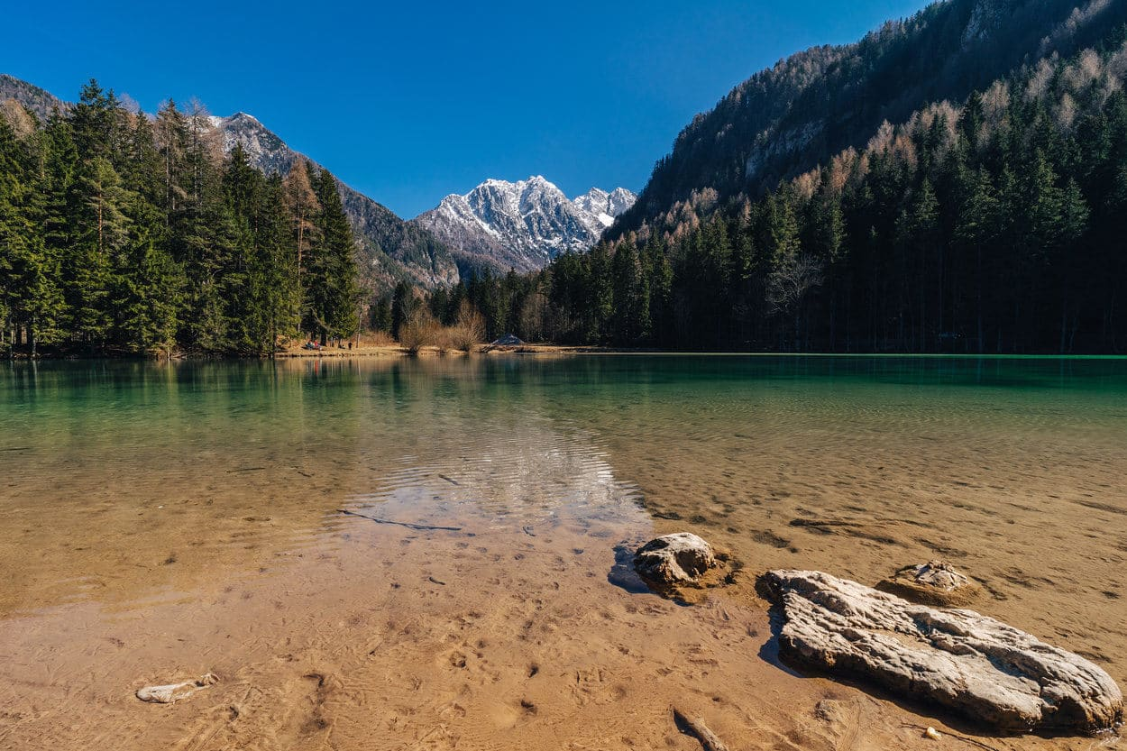 Lake in Jezersko with Kamnik Savinja Alps in background