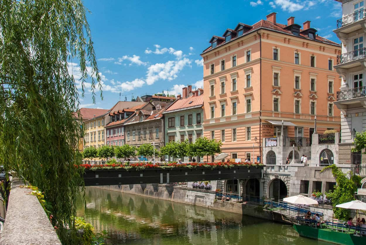 Sunny day in Ljubljana old town by the river