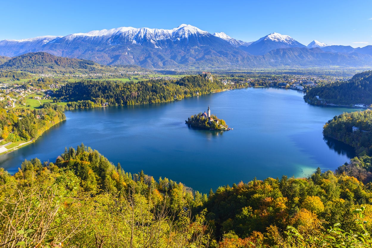 Lake Bled surrounded by snowy mountains