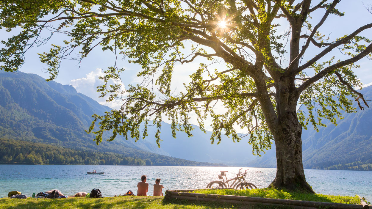 People sunbathing at Bohinj lake