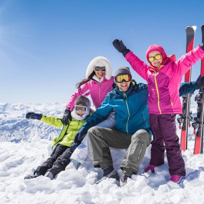 Family posing on skiing