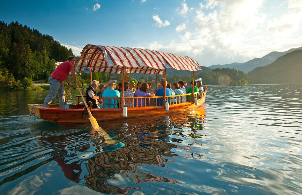 Group of people in the Bled pletna boat