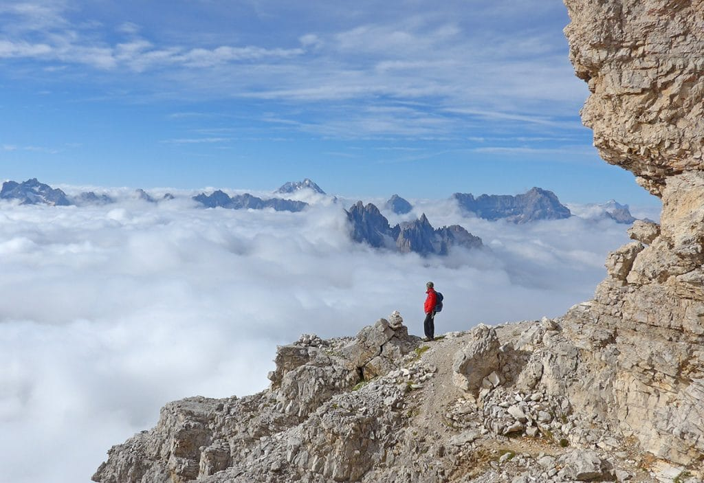 Climber in the Dolomites enjoys the view