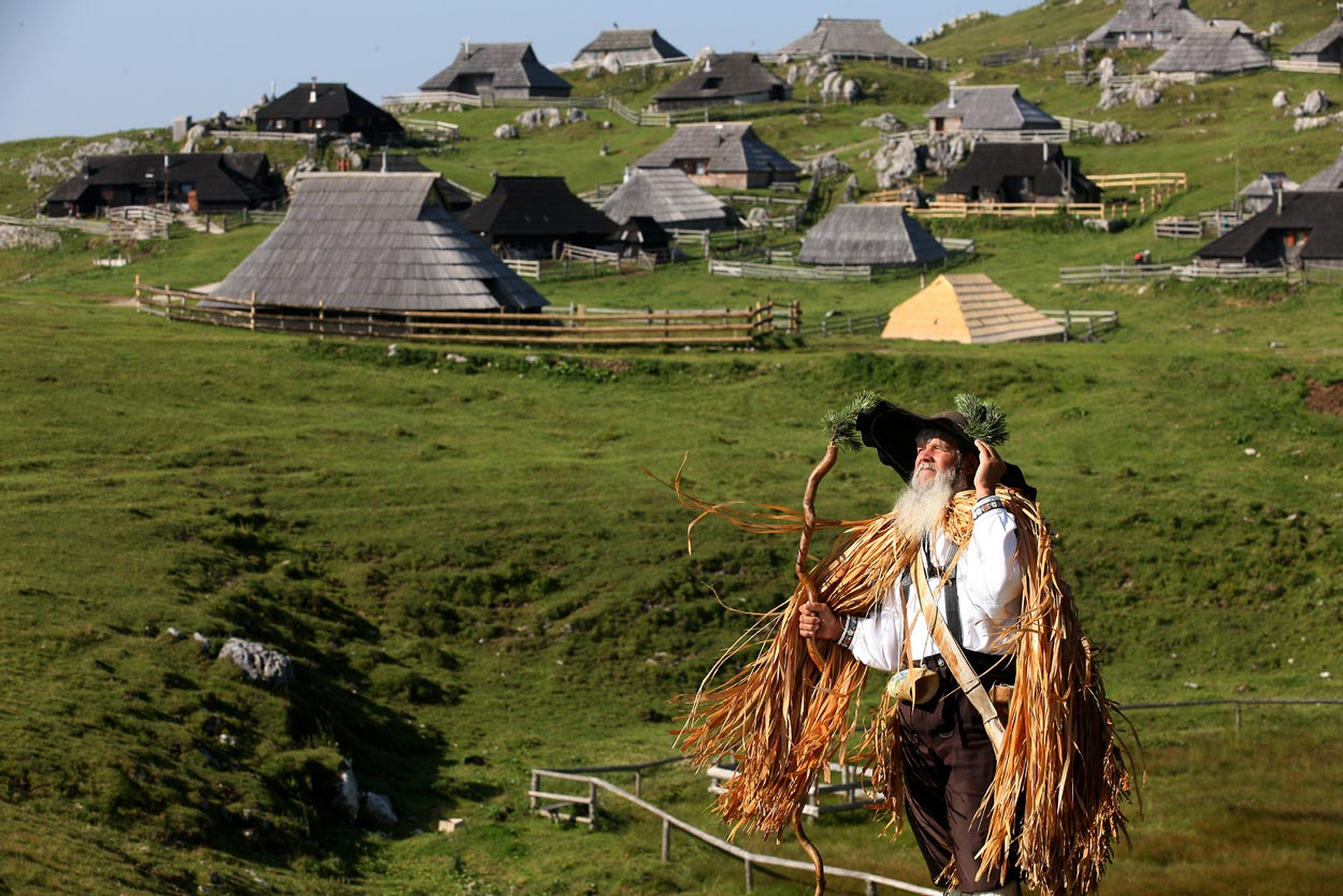 Man in front of Velika planina huts