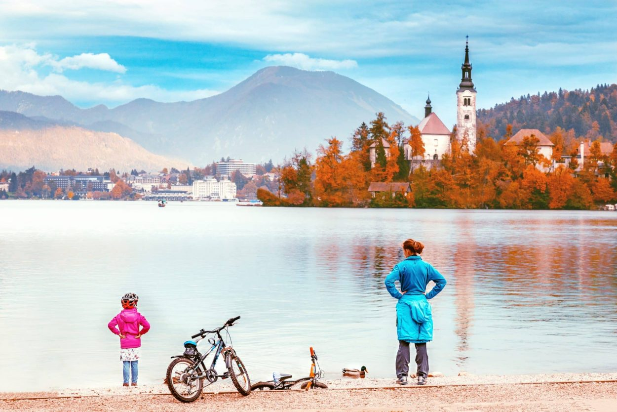 Mom and child at Lake Bled with bikes