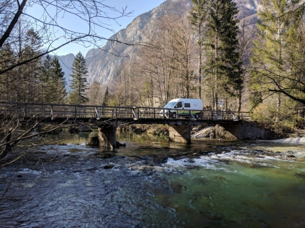 Campervan crossing a bridge over Savica River