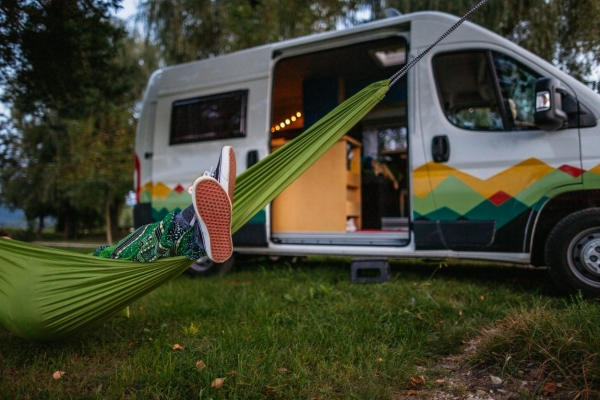 Hammock in front of a campervan