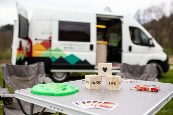Playing board games in front of a camper van
