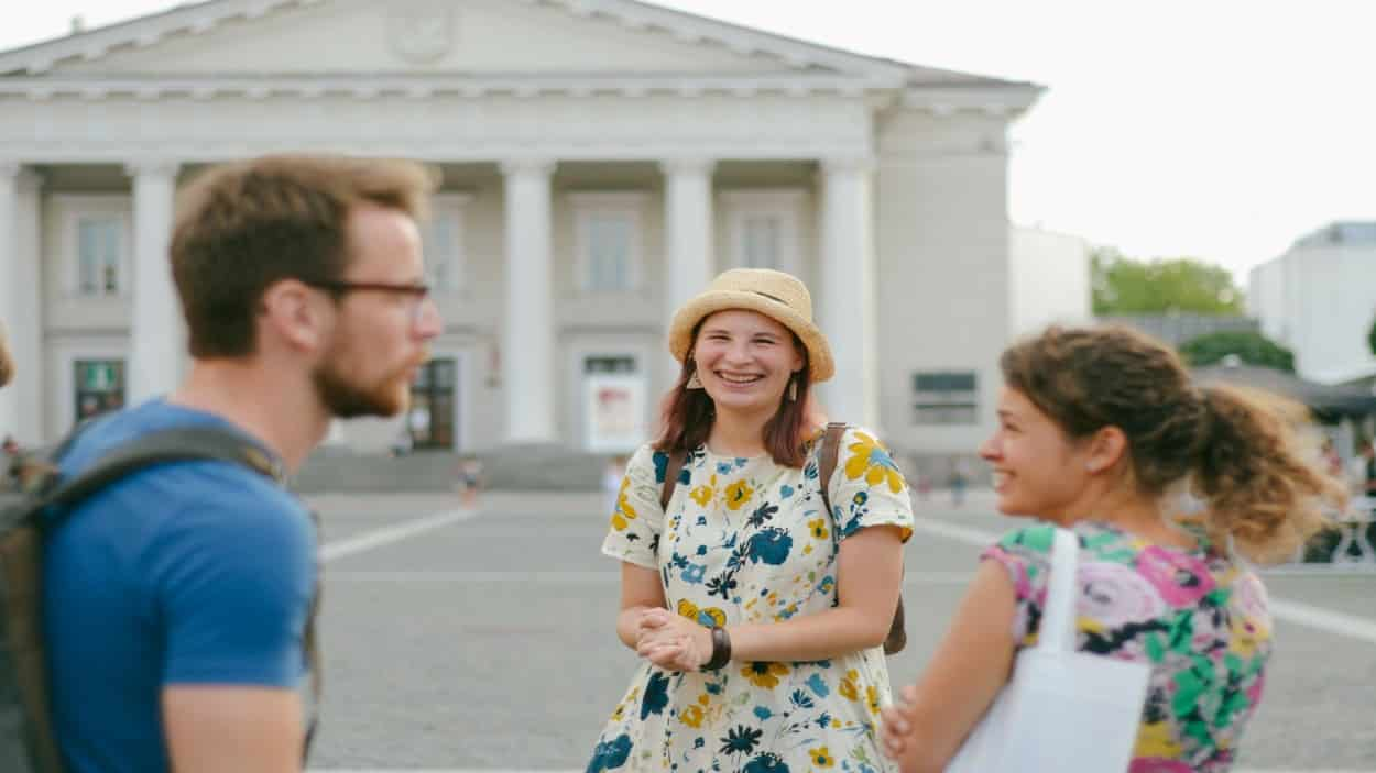 Couple with their guide on Vilnius town hall private tour