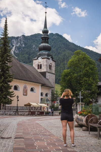 Girl taking photo in Kranjska Gora