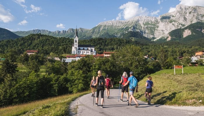 Drežnica village and mount krn in the background hikers