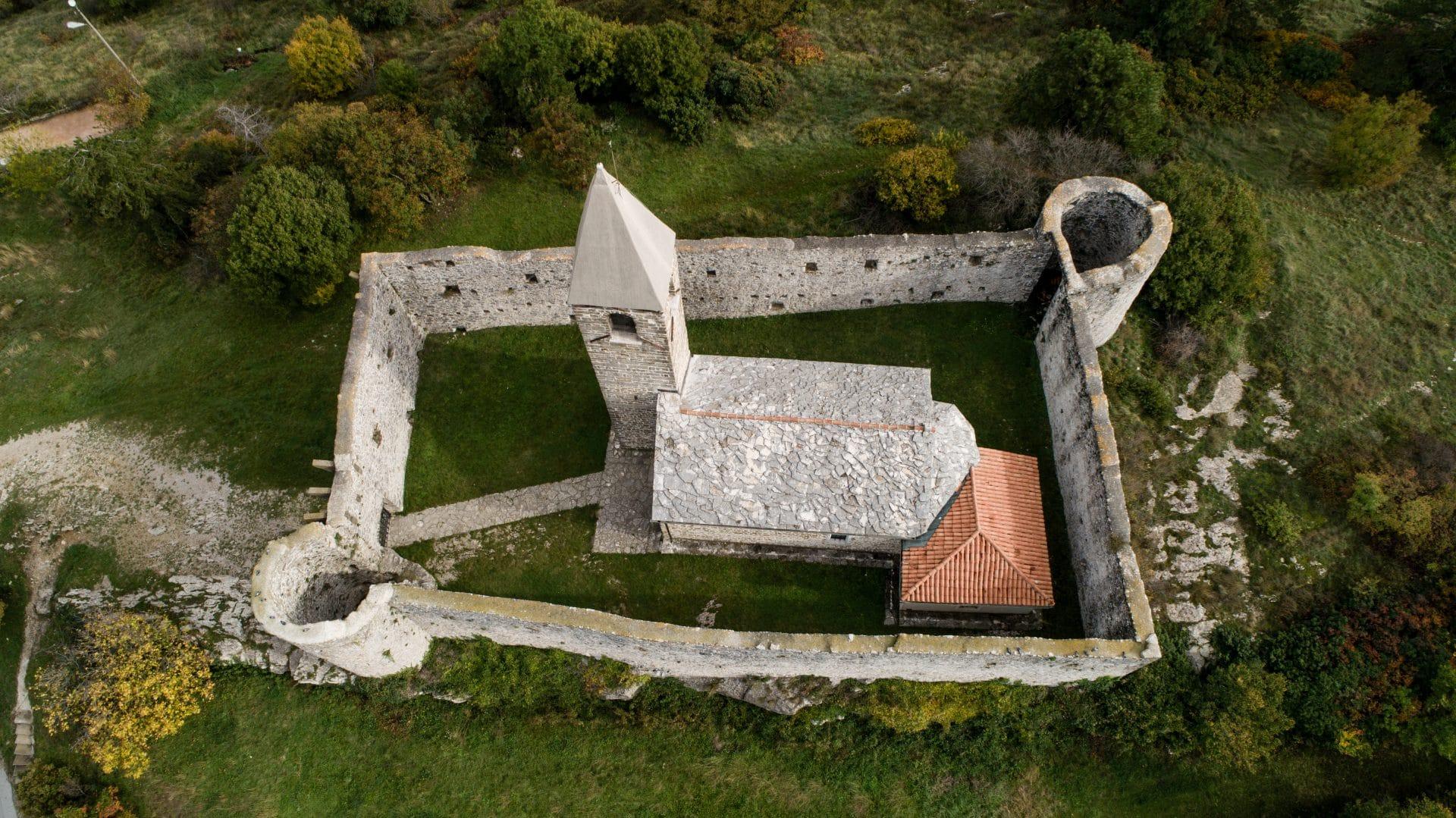 Hrastovlje walled romanesque church