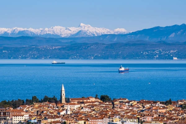 Izola with mountains in the background